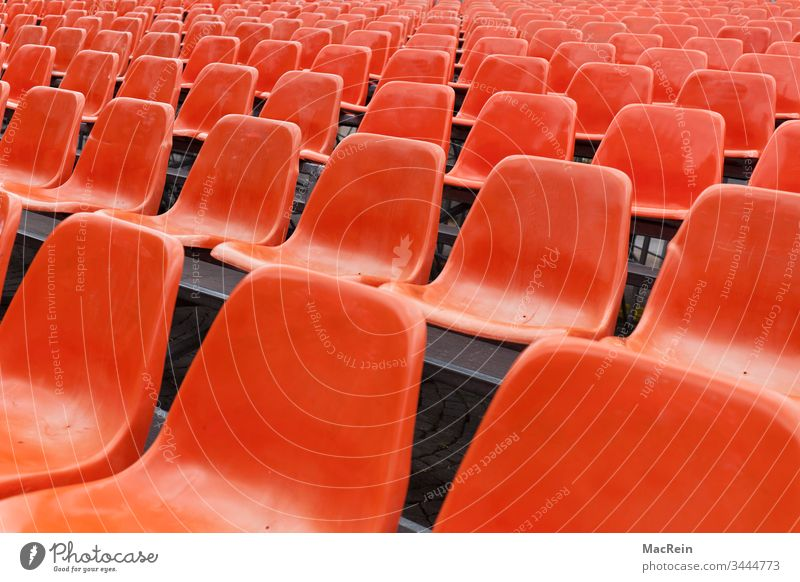 Red rows of seats Row of seats series chairs Empty unmanned vacant places Event nobody Copy Space Visitor