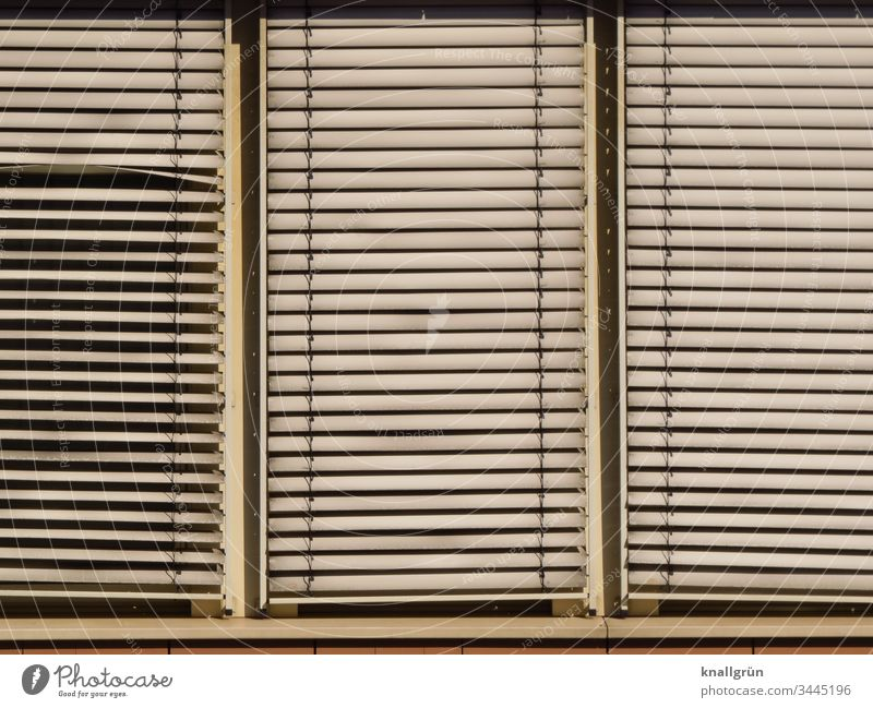 Three-part window with dirty aluminium blind Venetian blinds Window Protection Line Exterior shot Closed frowzy Dirty Structures and shapes Slat blinds slanting