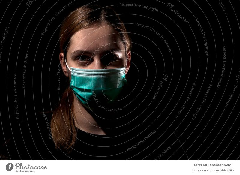 Woman with medical mask for protection of corona virus covid-19 SARS-CoV-2, woman with mask on black background 30s adult apocalyptic caucasian color