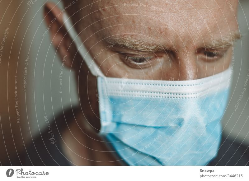Portrait of a man wearing a surgical mask medical young health protection care male people person white protective portrait adult isolated medicine face
