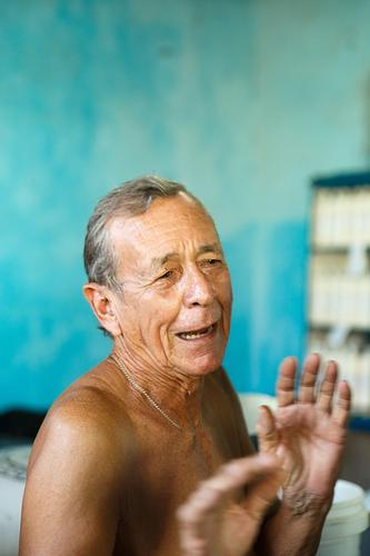 ancient man in a supply store-trinidad cuba caribean island cuban man old old man portrait handsome nice cute people street real people lifestyle smile