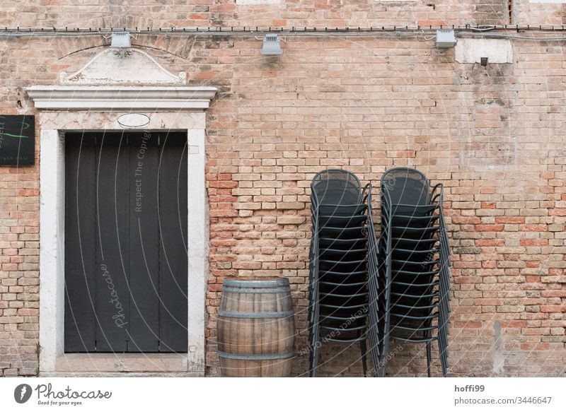 stacked chairs with wine barrel and historical facade Stack Brick Brick wall Keg Wine cask Old town Closed Chair Group of chairs Stack of chairs Minimalistic
