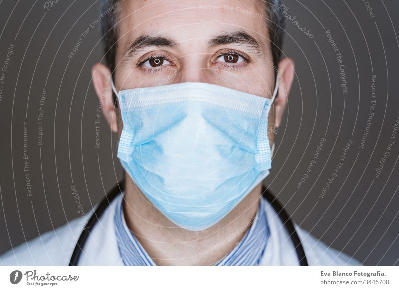 close up view of doctor man wearing protective mask and stethoscope. Coronavirus Covid-19 concept portrait professional corona virus hospital working infection
