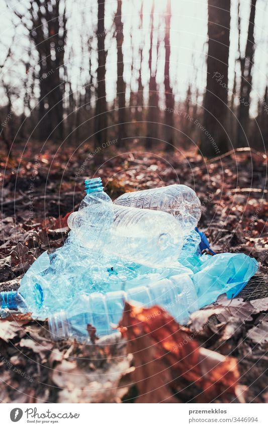 Plastic waste left in forest. Concept of plastic pollution and irresponsibility for environment. Environmental issue. Environmental damage. Real people, authentic situations