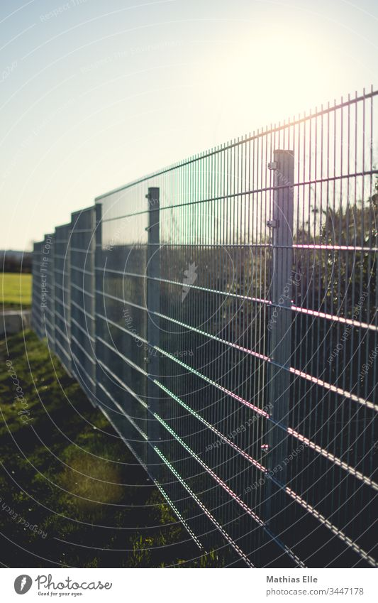 Galvanized metal fence Metal Fence Exterior shot Orderliness Protection Steel Network Deserted Structures and shapes Close-up Colour photo Get stuck Biased