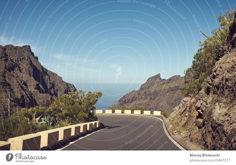 Scenic mountain road, Tenerife, Spain. trip journey landscape drive retro filtered vacation nature day travel summer no people sky rock cliff adventure