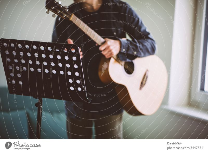 guitarist Guitar Guitarist music stand at home practice tutorial practicing Study diligence Motive Teacher schuler Lessons Music stand Education School