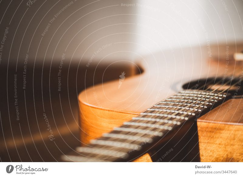 Guitar musical instrument lies on the floor and is illuminated by sunlight Lie Music Musical instrument Sunlight Ground Break time-out Copy Space top Shadow