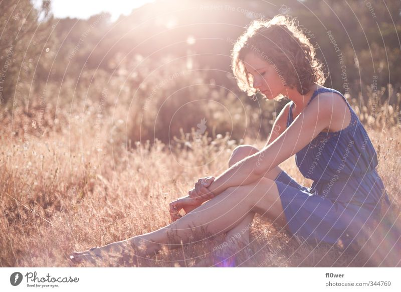 sun absorption Body Summer Human being Feminine Girl Young woman Youth (Young adults) Adults 1 18 - 30 years Nature Grass Bushes Sit Wait Blue Yellow Gold