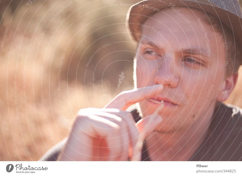 smoking awesome Masculine Young man Youth (Young adults) Man Adults Head 1 Human being 18 - 30 years Grass Bushes Fashion Hat Blonde Facial hair