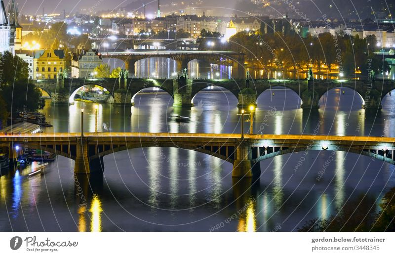 the bridges of Prague Night shot Panorama photo Colour photo little colour blue grey white black gold green Deserted Bridge in the foreground