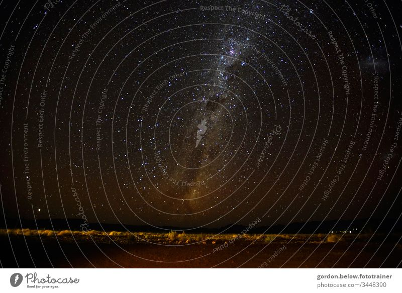Starry sky over Namibia Night shot Colour Panorama picture Long exposure Black Deserted Dark little flora Exterior shot Night sky Mountains in the background