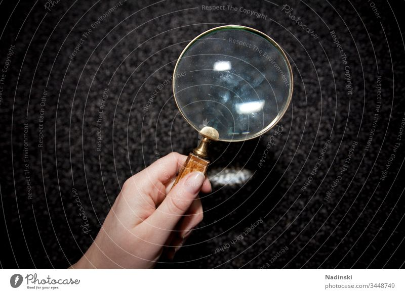Searching Magnifying glass Colour photo Lens Hand Human being Looking Glass search investigation Carpet mite infestation Mite Allergy Allergies Dust Detective