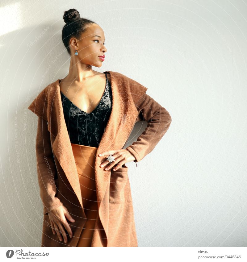 Lilian Woman feminine Coat Braids Jewellery Stand Skirt room Room Wall (building) Looking Beautiful self-confident Pride fashionable stop Rest on Earnest