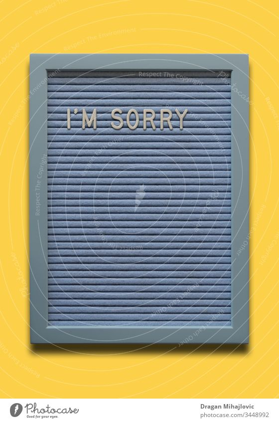 Light blue message board I`m sorry on the yellow background apologize apology banner card concept creative decoration decorative design emotion excuse feeling