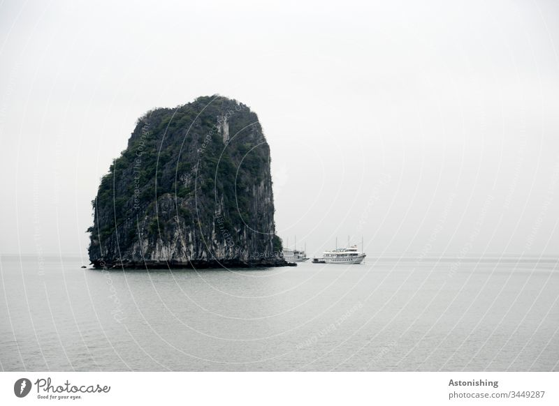 big rock in the Ha Long bay, Vietnam Halong Ha-Long Rock Stone Vacation & Travel Exterior shot Asia Halong bay Bay Nature Ocean Landscape Water Mountain