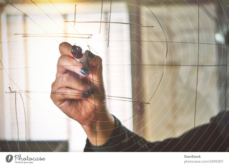 Hand of businesswoman writing on glass board in office hands drawing marker person screen people white background presentation write young space pen beautiful