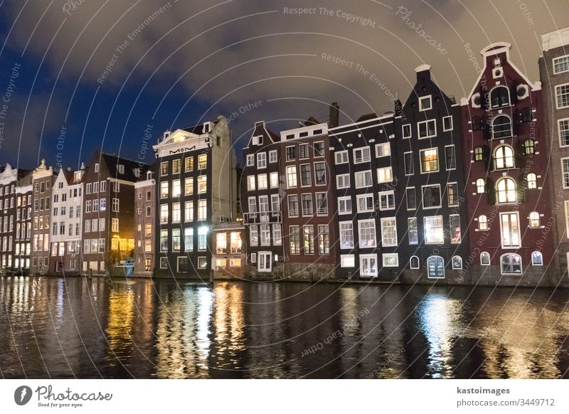 Beautiful tranquil scene of city of Amsterdam at dusk. Bicycles along the street and on the bridge over the canal. amsterdam netherlands architecture dutch