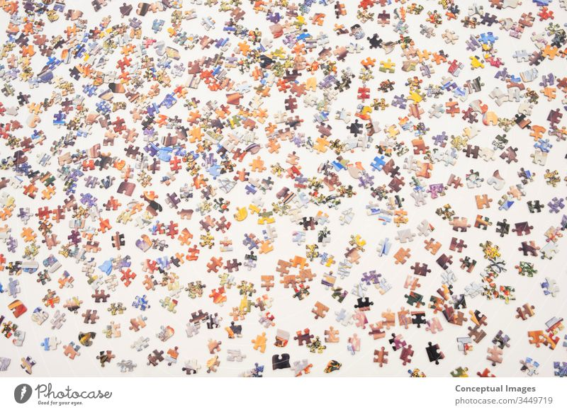 Top view of a jigsaw puzzle top view game home vibrant educational leisure creative puzzles preparation piece teamwork study challenge riddle concept patience
