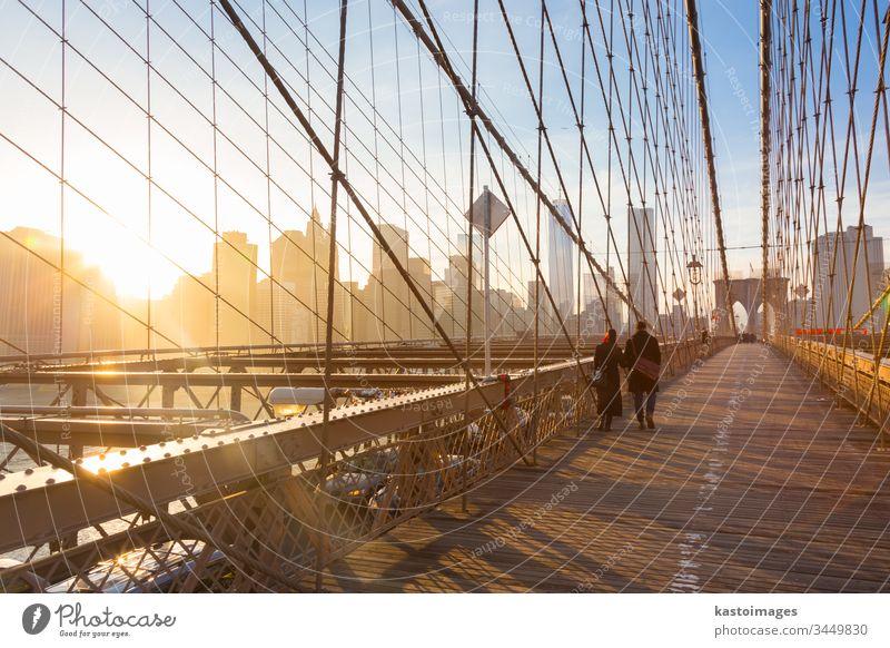 Brooklyn bridge at sunset, New York City. new york manhattan America brooklyn couple walk city skyline people usa skyscraper new york city cityscape romantic