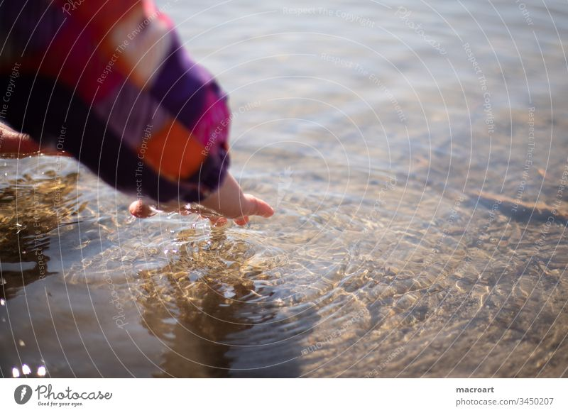 Child plays with water Girl Water Waves Hand Discover curious inquisitorial Playful Study Cold cold Spring Body of water Infancy untroubled Easy feel Fingers