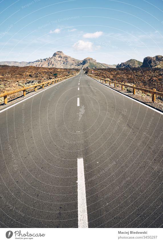 Asphalt road in Teide National Park, Tenerife. highway asphalt deserted landscape volcanic journey adventure travel road trip retro vintage filtered hill