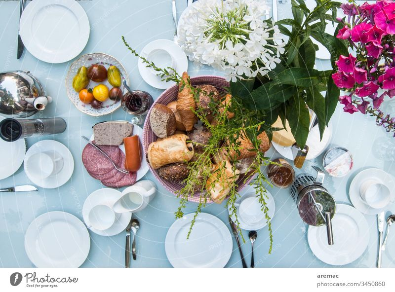 Set breakfast table Breakfast Table Crockery White flowers sausage Roll tomatoes Breakfast table covered Colour photo Food Plate Interior shot Baked goods