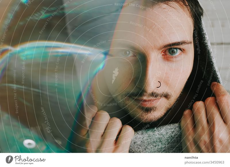 Artistic and futuristic portrait of an attractive young man guy face prism effect modern casual light art abstract artistic portraiture cool beard bearded