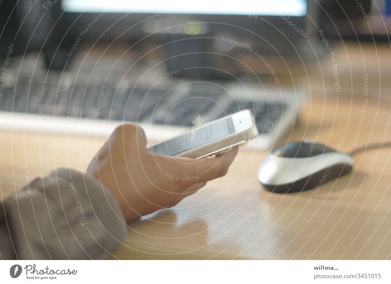 hand with smartphone on desk with keyboard and mouse Hand Keyboard Workplace Office Work and employment Desk Office work Inform PDA Media industry