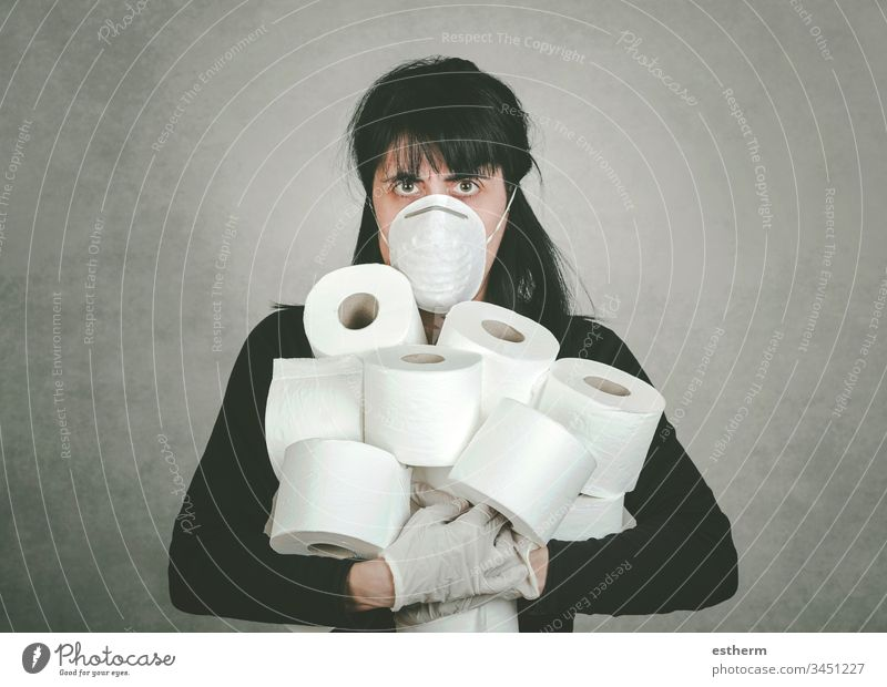 Crazy young woman grabbing rolls of toilet paper coronavirus crisis coronavirus health crisis selfishness Madness covid-19 empty consumer prevention shopping