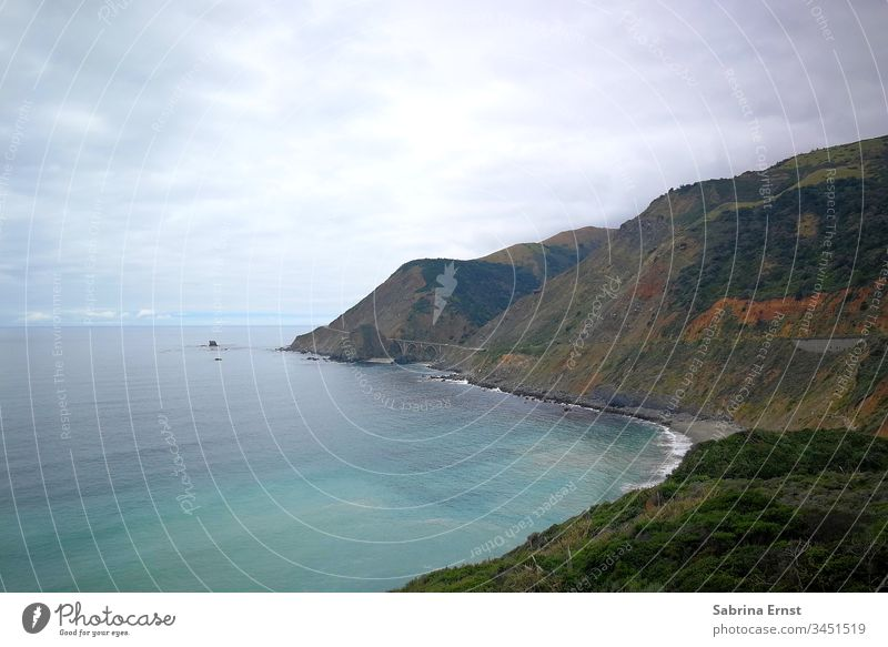 Coastal panorama of the Highway Number One Motorway number one Mountain Hill Bad weather cloudy Rough Ocean Water outlook view Nature Landscape Horizon Gray