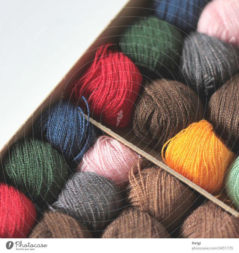 Stuffing yarn rolls - different coloured yarn rolls lie side by side in a box Thread rolls darning yarn threads Sewing Darning repair Nostalgia Sewing thread