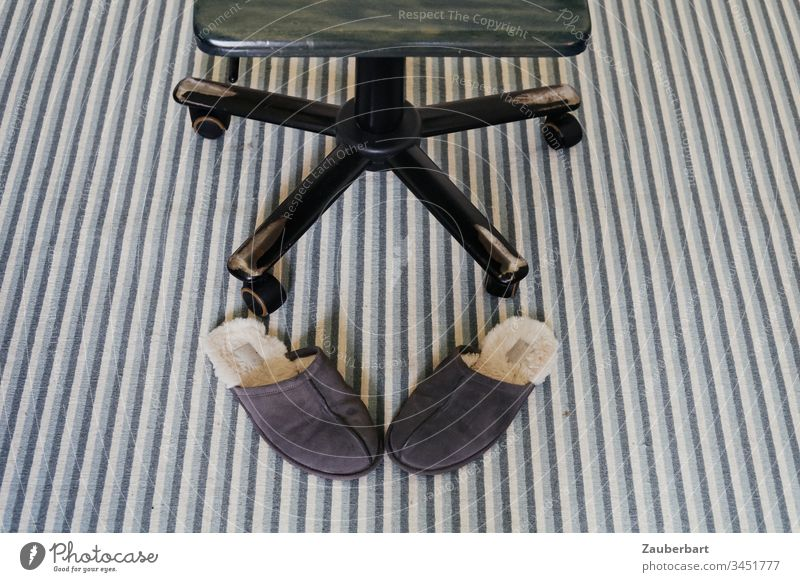 Desk chair on striped carpet is happy about the home office, in front of it slippers Slippers Carpet Stripe Green Interior shot Detail Colour photo Deserted