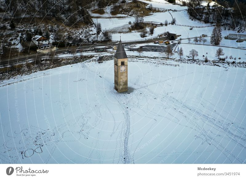church tower frozen lake Ice Ice-skating Lake Frozen Frozen water Kite Skiing Cold reschenpass Drone drone flight drone view Drone pictures Winter landscape