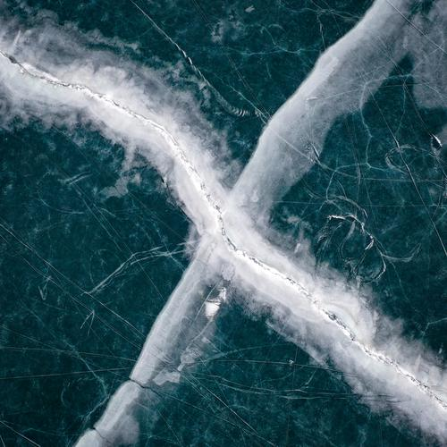 Ice lake tracks Ice-skating Lake Frozen Frozen water frozen lake Kite Skiing Cold reschenpass Drone drone flight drone view Drone pictures Winter landscape
