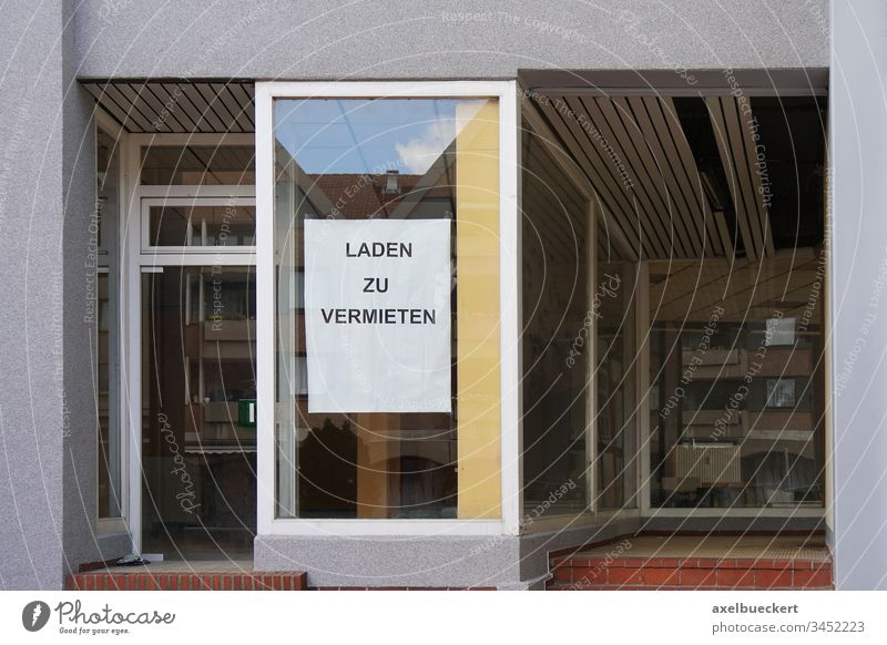 German sign reads store for rent shop lease german shopfront storefront window building house property architecture germany empty real estate realty abandoned