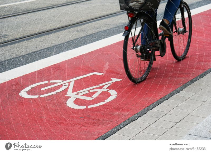 designated bike lane or cycle highway bicycle path cyclist cycling cycleway track traffic street red city symbol biking travel commute asphalt safety person