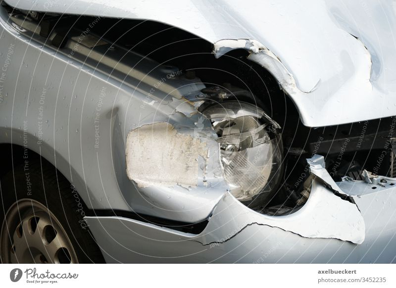 car wreck after fender bender crash auto accident crashed wrecked headlight hood headlamp bonnet small compact subcompact collision damage damaged involved