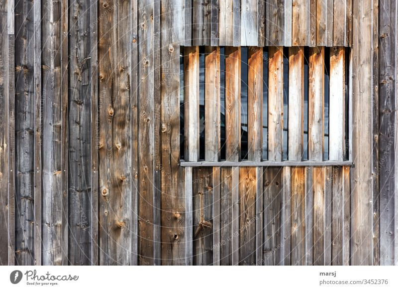 Wooden wall with a window barricaded with square timbers. Brown Wood grain Wall (building) Window Rectangle rectangular geometric Weathered Sharp-edged