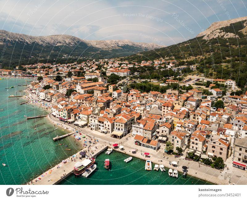 Aerial panoramic view of Baska town, popular touristic destination on island Krk, Croatia, Europe baska krk sea croatia city building harbor water summer