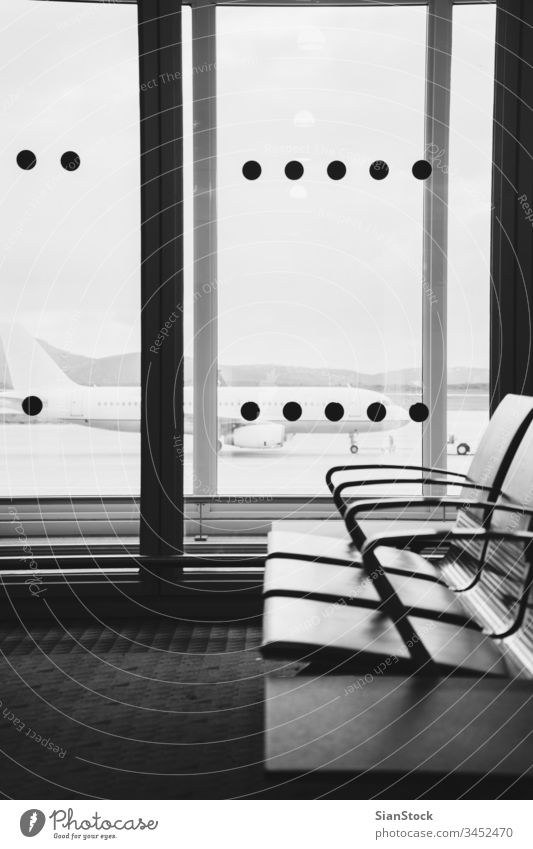 Empty airport terminal waiting area with chairs in Athens airport travel b/w black white flight airplane luggage departure transportation trip baggage