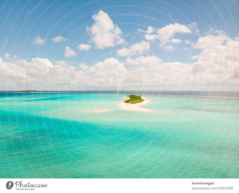 Picture perfect beach and turquoise lagoon on small tropical island on Maldives ocean sea coast sand landscape nature scenery tourism vacation water sky