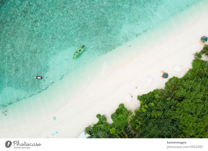 Aerial drone view of picture perfect beach and turquoise lagoon on small tropical island on Maldives ocean coast sea sand landscape nature scenery tourism