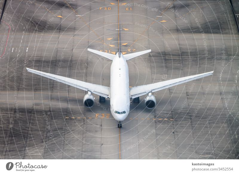 Airplane on a runway. airplane airport travel transport fly arrival background big cargo cockpit airline commercial transportation commercial airplane departing