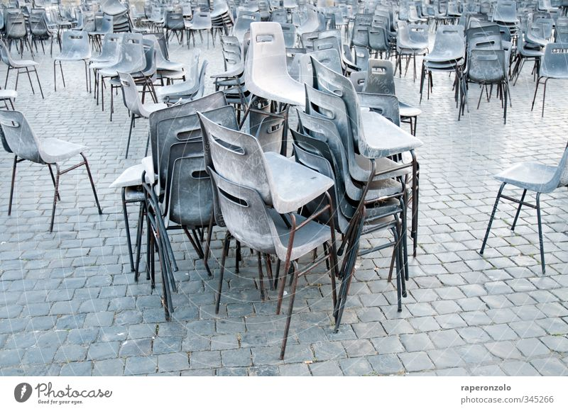 Find the table! Vacation & Travel Tourism Chair Event Culture Places Sit Stand Many Gray Stack pile Paving stone Gloomy mass Seating Empty Chaos Summer seated
