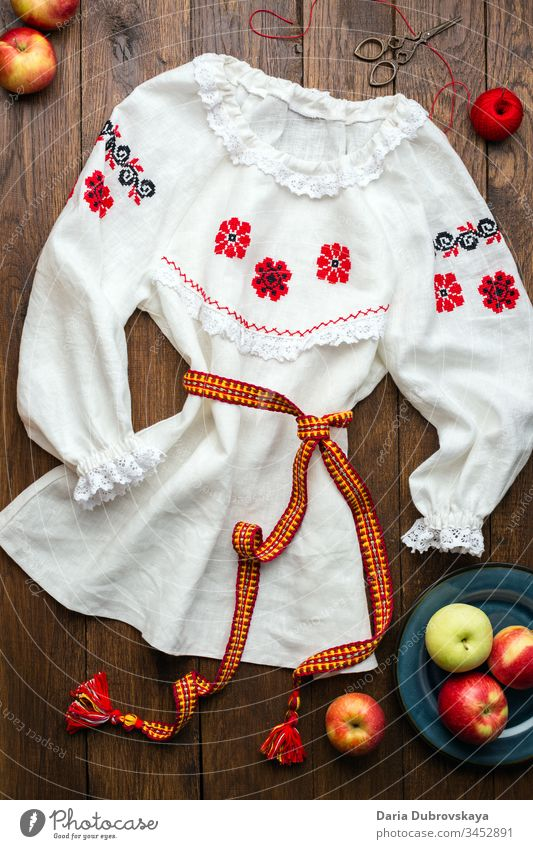 white linen shirt with hand-embroidered folk style fashion flower clothes embroidery thread homemade tradition national design ornament pattern needlework woman