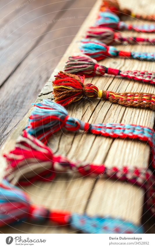 woven belts from colored threads in ethnic style colorful culture background textile texture natural handmade design white craft folk pattern retro nature