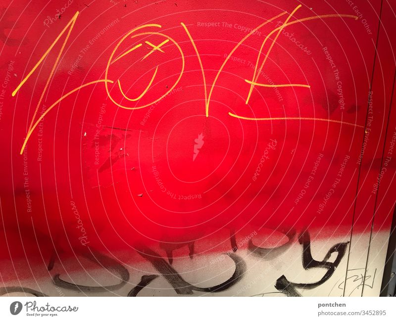 graffiti yellow writing on red background english word love, smiley and black smear Smiley Graffiti Subculture bribe Red Yellow Black Youth culture illicit
