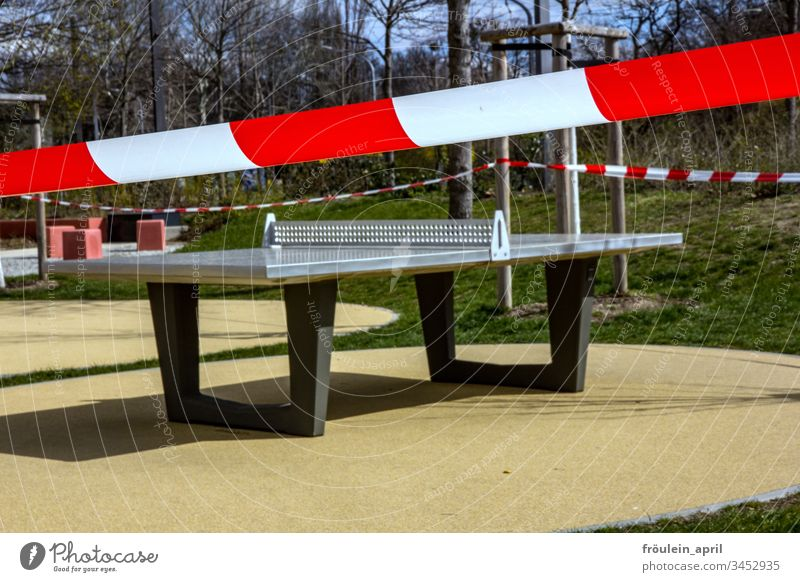 closed-off playground cordoned off Playground Table tennis table corona Restriction Empty forbid flutterband Day coronavirus Protection Risk of infection