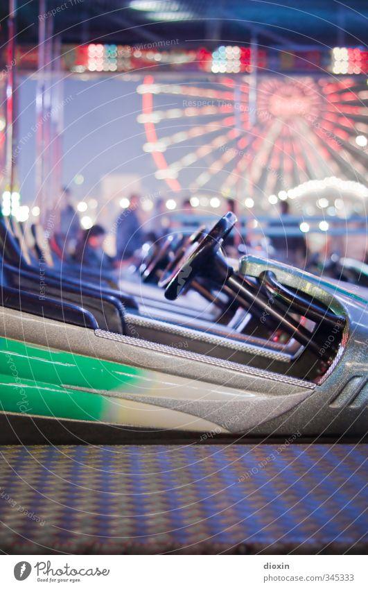 on a confrontational course Leisure and hobbies Fairs & Carnivals Bumper car Ferris wheel Joy Happiness Joie de vivre (Vitality) Theme-park rides Colour photo